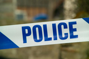 Police tape (CC licensed by freefotouk on Flickr).jpg